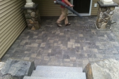 Granite steps and Belgard Pavers installed in Gilford, New Hampshire.