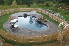 Pavers installed around a pool deck in New Hampshire